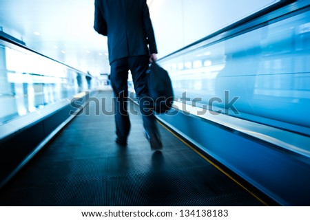 movement of abstract escalator with people. - stock photo