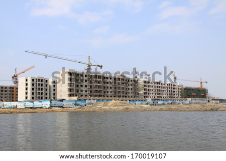movements of the housing construction site under the sky, northern china - stock photo