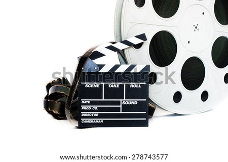 Movie clapper and vintage 35 mm film cinema reel on white background filmstrip unrolled - stock photo