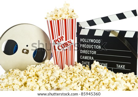 Movie Clapper Board in popcorn with film reel isolated on white - stock photo