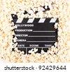 movie clapper board with popcorn - stock photo