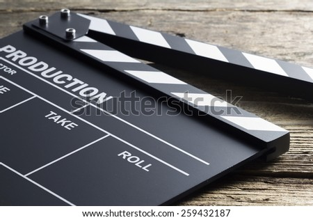 Movie clapper on wood background - stock photo