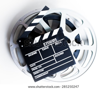 Movie clapper with vintage empty film reels on white background - stock photo