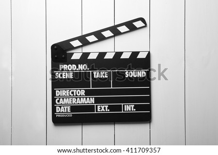 Movie clapperboard on wooden background - stock photo
