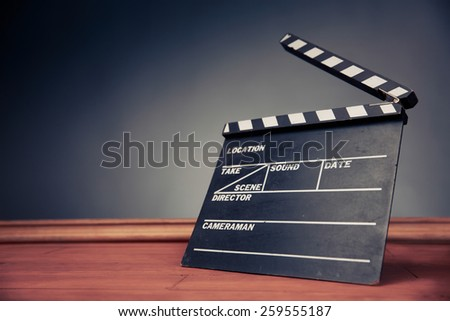 movie industry object on a grey background - stock photo