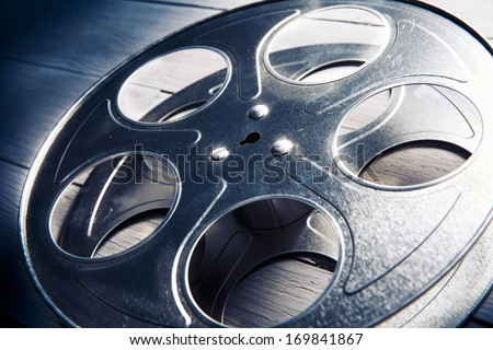 Movie reel on a wooden background - stock photo