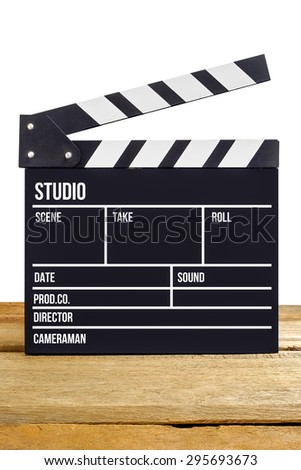 Movie slate film on wooden table, isolate background - stock photo