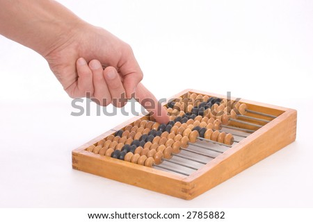 moving bones on the counting frame by hand - stock photo
