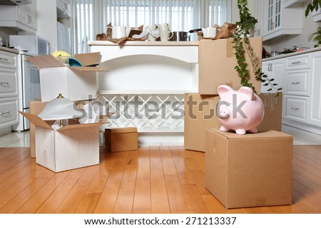 Moving boxes in new house. New apartment background. - stock photo