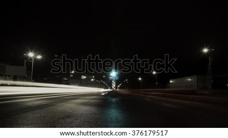 moving car with light through city at night - stock photo