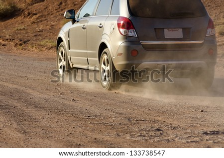 moving cars in Monument Valley in Utah in the United States of America - stock photo
