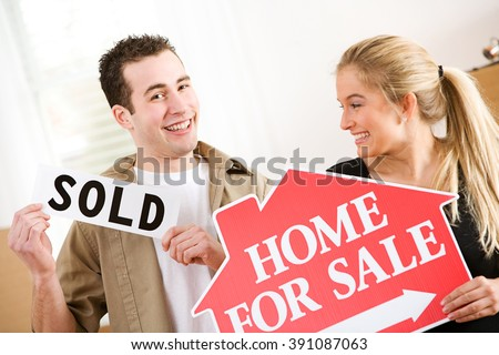 Moving: Couple Excited To Sell Home - stock photo