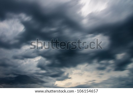 moving dark storm clouds before rain - stock photo