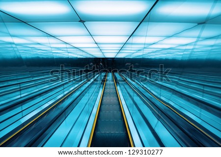 moving escalator in modern building,abstract space background - stock photo