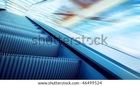 Moving escalator on the railway station - stock photo
