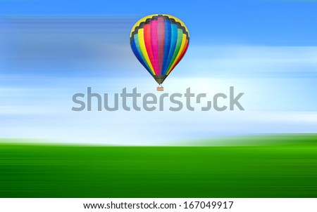 Moving Hot air balloon floating in the blue sky with motion blur - stock photo