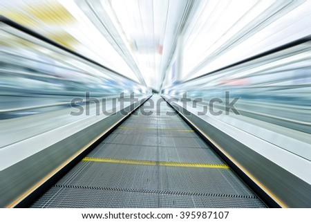 Moving modern escalator blurry image - stock photo