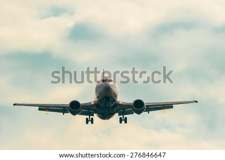 moving passenger plane in the sky - stock photo