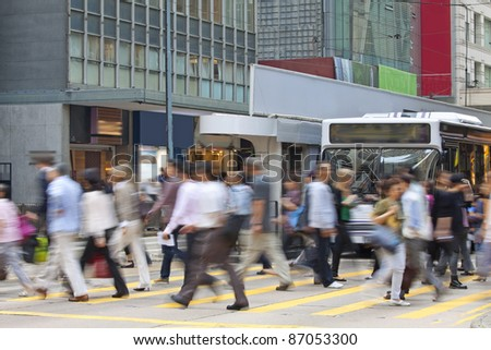 Moving pedestrian in business district, blurred motion. - stock photo