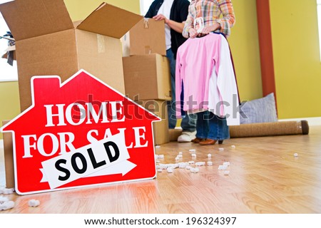Moving: Real Estate Sign With Sold Over It - stock photo