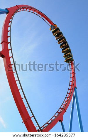 Moving roller coaster with blue sky. - stock photo