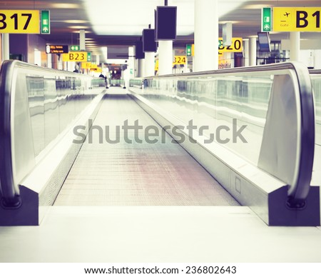 Moving sidewalk at an airport. Filtered toned image in instagram style.  - stock photo