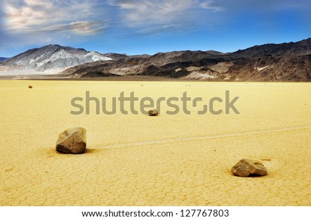 moving stones on playa, Death valley - stock photo