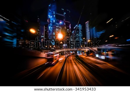 Moving through modern city street with illuminated skyscrapers. Hong Kong. Abstract cityscape traffic background with motion blur, art toning - stock photo