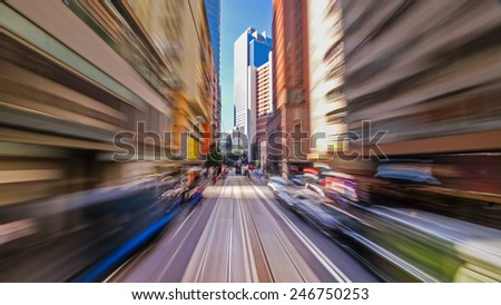 Moving through modern city street with skyscrapers. Hong Kong. Abstract cityscape traffic background with motion blur - stock photo