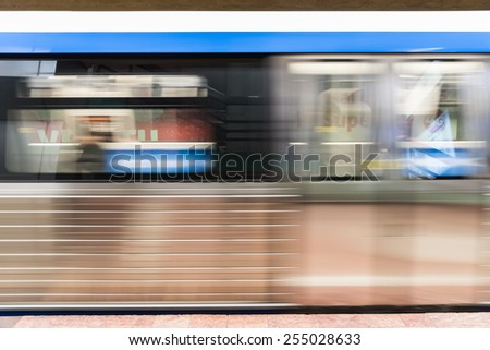 Moving Train In Subway Station - stock photo