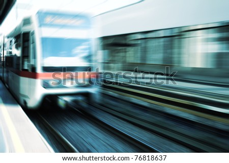 Moving train on platform - stock photo