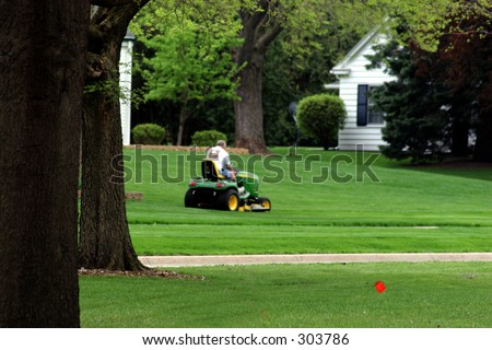 Mowing lawn - stock photo