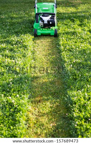 Mowing the high lawn - stock photo