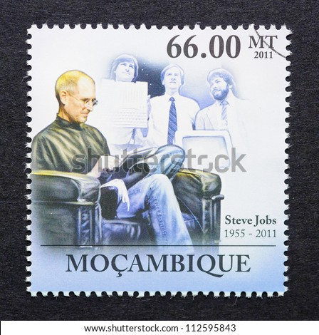 MOZAMBIQUE - CIRCA 2011: a postage stamp printed in Mozambique showing an image of Steve Jobs using an ipad, circa 2011. - stock photo