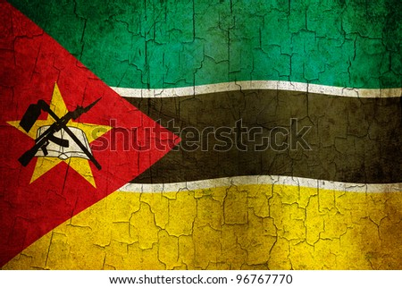 Mozambique flag on a cracked grunge background - stock photo