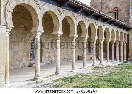 Mozarabic monastery of San Miguel de Escalada in Leon, Detail of the exterior arches - stock photo