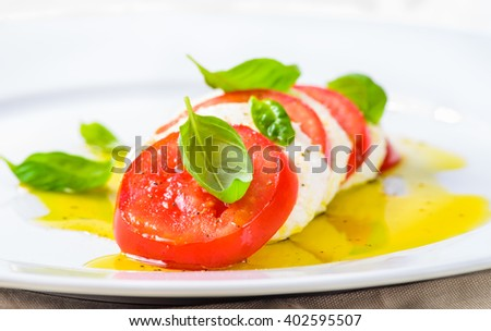 Mozzarella and tomatoes, caprese salad.Italian food, cuisine.Restaurant menu plate. - stock photo