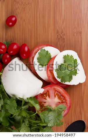 Mozzarella cheese on a wooden plate. Healthy food. - stock photo