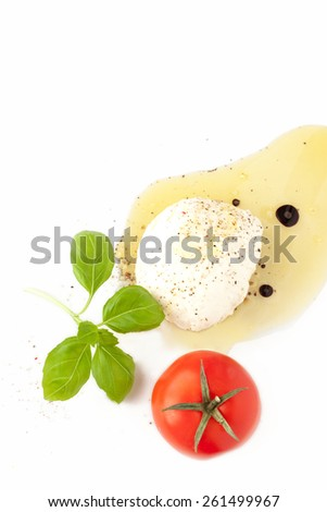 Mozzarella cheese, tomato, basil and olive oil on white background from above. Italian caprese salad recipe ingredients. Layout with free text space. - stock photo
