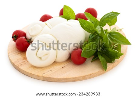 Mozzarella, cherry tomatoes  and basil on cutting board. Isolated on white background. - stock photo