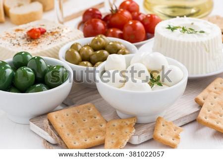 mozzarella, pickles and crackers, horizontal - stock photo