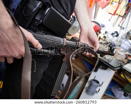 MP38 in the hands of a master restorer in the interior locksmith gunsmith - stock photo