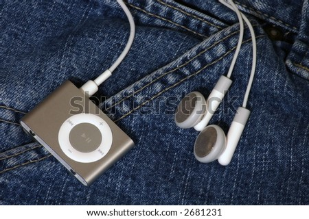 mp3 player clipped to a pocket - stock photo
