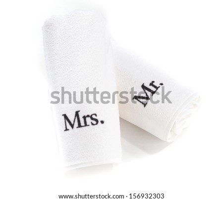mr and mrs rolled white towels isolated on a white background - stock photo