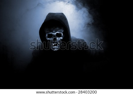 Mr death in hood and smoke - stock photo