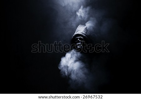 Mr death with hood in smoke - stock photo