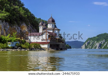 Mraconia Monastery is the only Romanian monastery built between the rocky banck of the Danube and its waters , located 15 Km west of the Romanian port town Orsova - stock photo