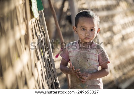 Mrauk U, MYANMAR - DEC 15, 2014: Unidentified Burmese boy in Mrauk U on December 15, 2014 in Mrauk U, Myanmar. - stock photo