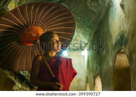 MRAUK U, MYANMAR - JAN 18: Unindetified young novice on Jan 18, 2016 in Mrauk U, Myanmar. Buddhism is predominantly of the Theravada tradition, practiced by 89% of the population. - stock photo