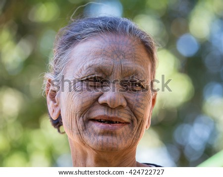 MRAUK-U, MYANMAR - JANUARY 27, 2016: The portrait of Chin woman with spider tattoo. Chin people, also known as the Kukis are a number of Tibeto Burman tribal people. - stock photo